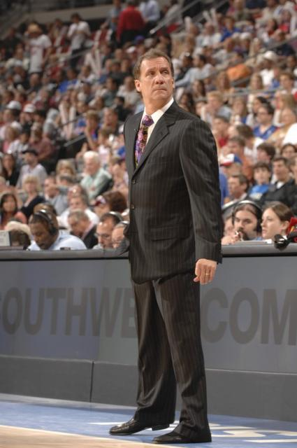 Flip Saunders in black suit looks on from the sidelines.jpg