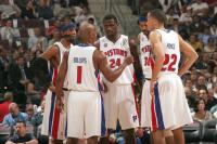 Pistons teammates gather around to discuss.jpg