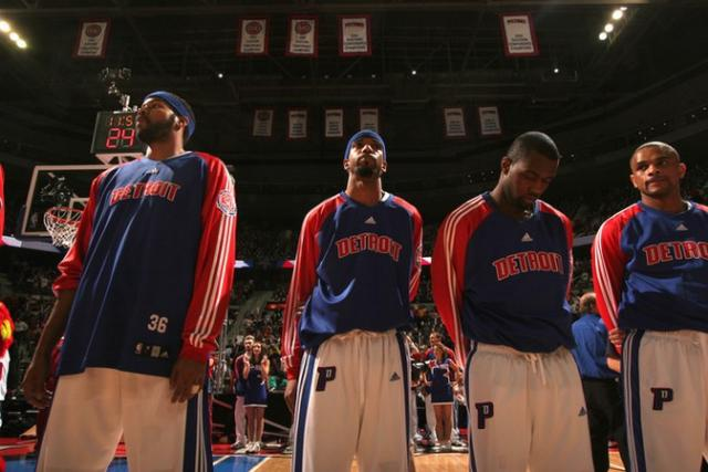 Several Pistons players look on during the national anthem.jpg