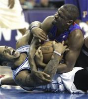 Lindsey Hunter fights for the loose ball with Jameer Nelson.jpg