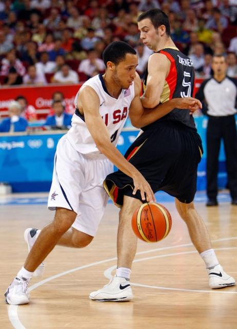 Tayshaun Prince drives past a German player in the Olympics.jpg