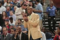 Chauncey Billups applauds his teammates from the sideline.jpg