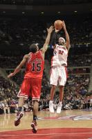 Rip Hamilton shoots a jumper against John Salmons.jpg