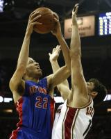 Tayshaun Prince powers one up against Wally Szczerbiak.jpg