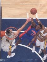 Will Bynum puts up a contested shot inisde.jpg