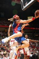 Walter Herrmann goes for an acrobatic layup.jpg