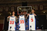 Pistons draftees Jonas Jerebko Dajuan Summers and Austin Daye hold their Pistons jerseys.jpg