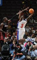 Rodney Stuckey goes to the hoop against Dwayne Wade in a 2009 preseason game.JPG