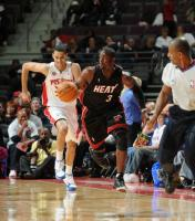 Austin Daye runs back on defense behind Dwayne Wade.JPG