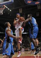 Charlie Villanueva rebounds the ball against Orlando.JPG