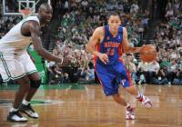 Tayshaun Prince drives past Kevin Garnett.jpg